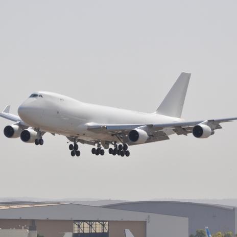 white air cargo plane descending